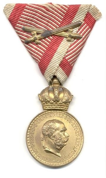 bronze military merit medal with swords obverse